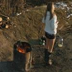 Roadside hooker standing by the fire