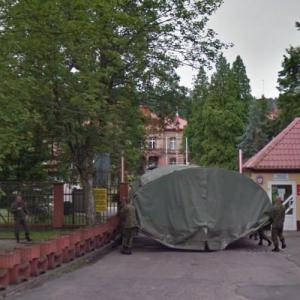 Soldiers carrying a tent (StreetView)