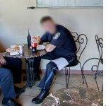 Boston policeman having lunch (StreetView)