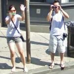 Couple photographing the Google car