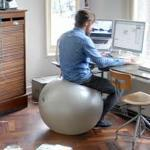 Man Sitting on an Exercise Ball