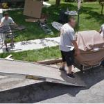 People Unloading Furniture