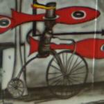 Penny farthing bicycle in a mural (StreetView)