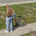 Bicyclist lost in thought (StreetView)