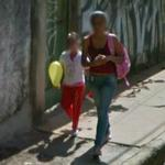 Child holding a helium balloon (StreetView)