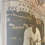 Jackie Robinson Breaks Racial Barrier