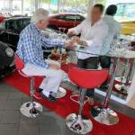 Luxury Car Dealer Serves a Drink