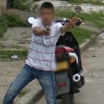 Boy with a gun (StreetView)