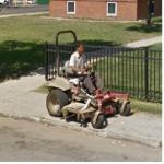 Guy Driving A Big Mower