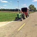 Man Pulling a Trailer With His John Deere