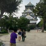 Man photographing women at Osaka castle