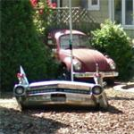 Automotive yard art (StreetView)