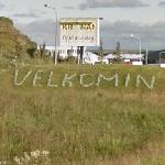 "Velkomin ""Welcome"" sign"