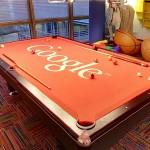 Google logo on a pool table