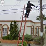 Telephone lineman on a ladder, Rosarito, Mexico