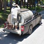 Man riding on the tailgate of a pickup