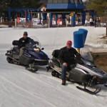 Guys on snowmobiles