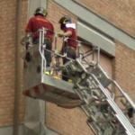 Firefighters in a bucket overhead