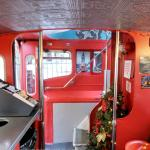 Dining in a red double-decker bus
