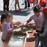 Children playing checkers