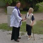 Priest shaking the hand of a faithful