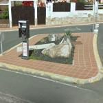 Phone booth on a traffic island