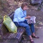Lady reading a newspaper