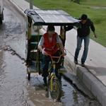 Rickshaw in a puddle