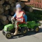 kid on mini tractor