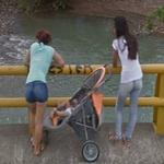 Girls looking at something in the river