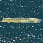 Landshark beer banner towed by a plane