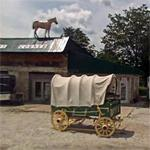 Covered wagon and a horse on the roof