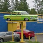 Corvair on a sign pole (StreetView)