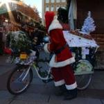 Santa pushing a bicycle