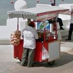 Person Selling Food From a Cart