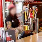 Person Pulling a Beer From a Beer Tap