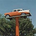 1956 Chevy on a sign pole (StreetView)