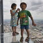 Kids on the glass balcony of Willis Tower