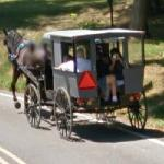 Tourists in an Amish buggy