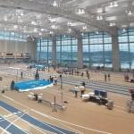 Indoor track meet in progress