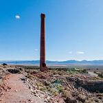 Abandoned smelter stack at Belmont Mill (StreetView)