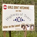 "Warning sign on Highway 16 stating ""Girls don't hitchhike""."