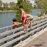Bridge jumping kids