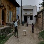 Children playing cricket (StreetView)