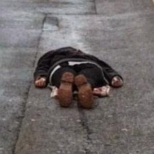 Man lying on the ground (StreetView)