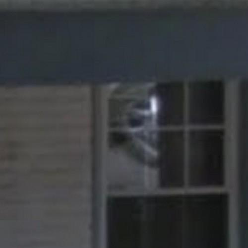 Scary Face In The Window Of The Sallie Ghost House In