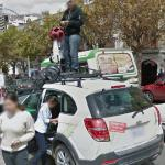 Google employee on top of the Google car