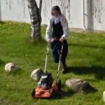 Nun mowing the lawn