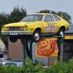 Ford Pinto on sign poles in France