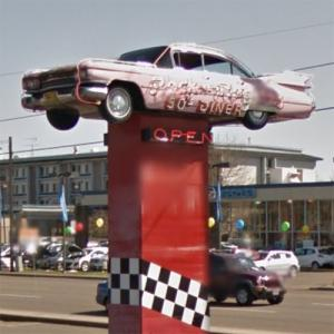 1959 Pink Cadillac on a sign pole (StreetView)